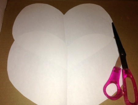 Heart Symmetry Paintings - fold paper in half and cut out heart shapes
