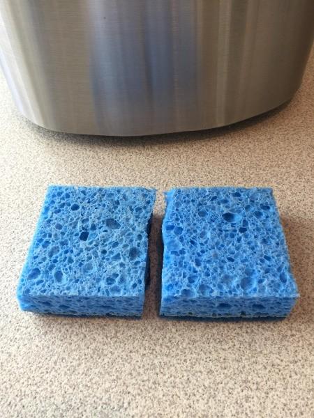 Make Your Sponge Last Twice as Long - blue sponge cut in half