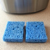 Make Your Sponge Last Twice as Long - blue sponge cut in half