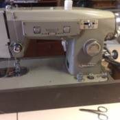 Finding User Manual for Vactric Sewing Machine - sewing machine in carrying case base
