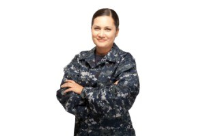 A woman in a U.S. Navy camouflage uniform.
