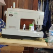 Removing a Kenmore Sewing Machine from Its Cabinet - sewing machine on a work table