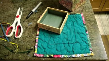 Make a Jewelry Box from a Pot Holder - center lid or box on the plain side of the pot holder, check fit the size