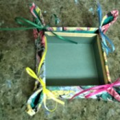 Make a Jewelry Box from a Pot Holder - corners of the pot holder pinched together and tied with a bow