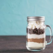 Hot chocolate mix in a jar with a handle.