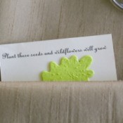 Flower seeds wedding favor in a beige napkin.