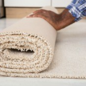 A roll of carpet with a raw edge.
