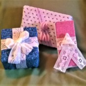 Fabric Covered Display Boxes - display packages wrapped in fabric and tied with lace bows