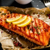 Cajun Fried Salmon topped with lemon slices.