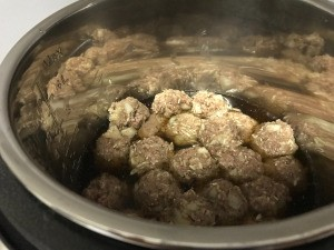 formed meatballs in pot