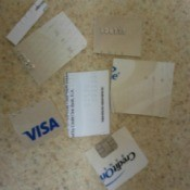 Several credit cards cut into pieces.