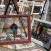 Many Stained Glass Windows leaning against each other at flea market.