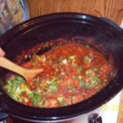 A crockpot of spaghetti sauce made with juiced vegetables.