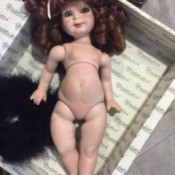 Identifying a Porcelain Doll  - undressed doll with red ringlets