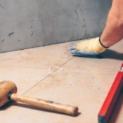 Tile installer with level and mallet