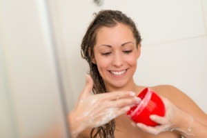 Woman using Homemade Conditioning Rinse in the shower
