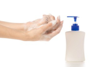 Woman washing her hands with bubble bath soap