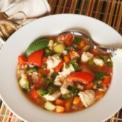 Chicken Vegetable soup in a bowl with spoon