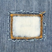 Close-up of jeans with a patch sewn on