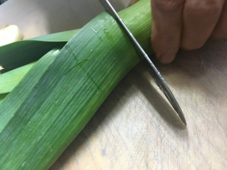 Cutting top off leek