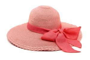 Faded red sun hat with a red bow.