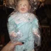 Value of a Knowles Doll - boy doll wrapped in plastic