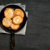 Fritters Cakes in a cast iron pan.