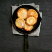 Fritter Cakes in a cast iron pan.