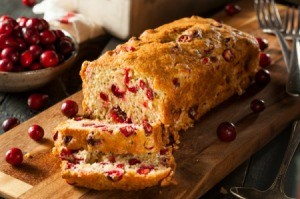 Cranberry Bread with fresh cranberries scattered about.