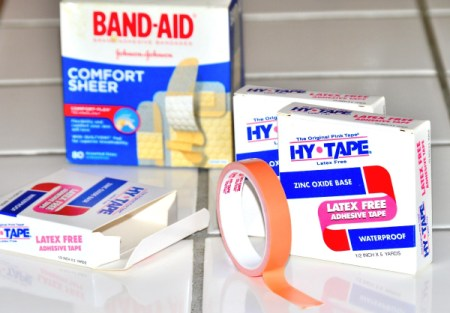 Packages of Band-Aids and Hy-Tape for covering healing wounds.