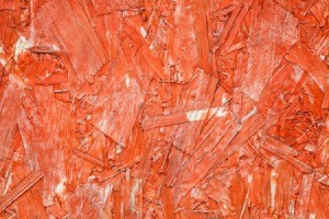 Particle board painted redish-Orange.