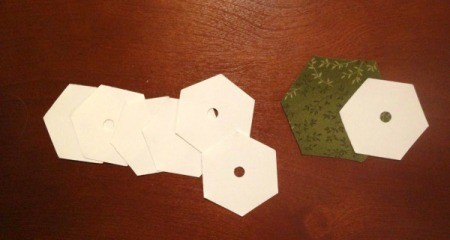 English Paper Pieced Hexagons - hexagon templates and one piece of cut fabric