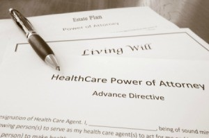 Paperwork for a healthcare power of attorney, living will and an estate plan.