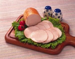 Sliced ham on a cutting board.