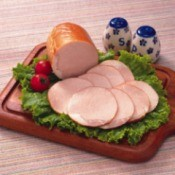 Sliced ham on a cutting board.