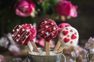 Valentines day cake pops with rose in background