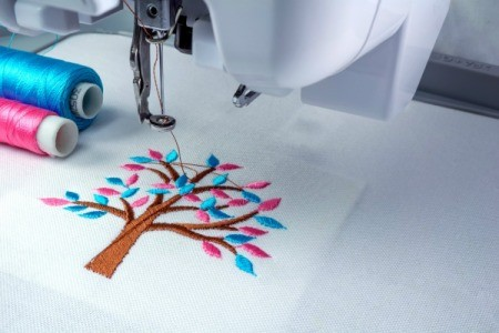 Sewing machine Embroidery of tree with pink and blue leaves