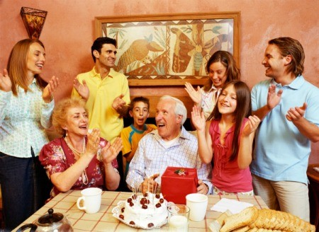 Friends and family celebrating retirement and birthday of older man