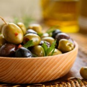 Roasted Olives in a wood bowl.