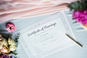 Marriage Certificate with flowers and a pen