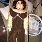 Identifying a Porcelain Doll - doll wearing a brown jumpsuit in the box