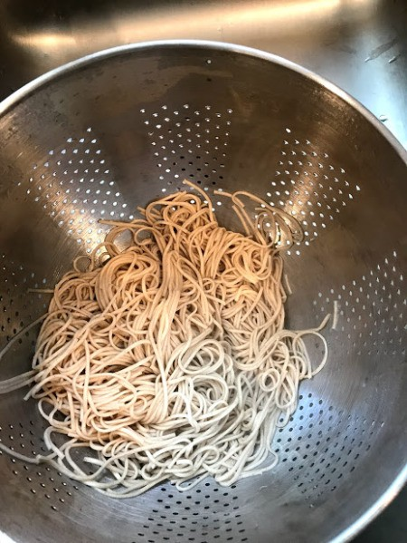 Soba noodles in collander