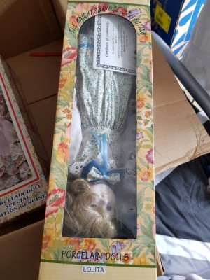 Value of a Knightsbridge Collection Porcelain Doll - doll upside down in the box