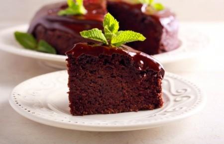 Slice of moist chocolate cake.