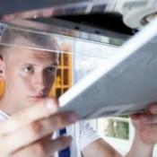 Man replacing an exhaust fan.