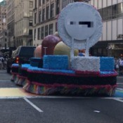 Parade float on a street.