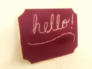DIY Chalkboard Paint - finished chalk board surface with hello written on it