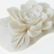 Flower carved into a bar of soap.