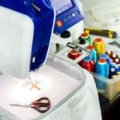 Embroidery machine with a small pair of scissors.