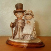 Value of 1980s Capodimonte Porcelain Figurines  - boy with top hat and girl in period bridal dress